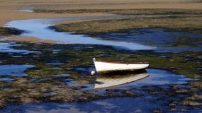 Dingy in Knysna Lagoon at Low Tide. Solitary dingy at low tide in Knysna Lagoon, Knysna, South Africa Stock Photography