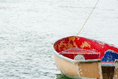 Dingy moored on the water waiting for use royalty free stock photo