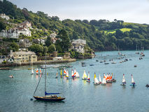 Dingy Racing the River Dart, Devon. Image of The River Dart and a Laser Dingy Race on the Estuary Royalty Free Stock Image