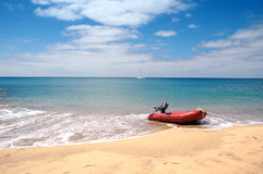 A dingy on the tropical beach. A dingy on the ocean in a tropical paradise Stock Photo