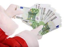 Dinheiro à disposicão de Papai Noel fotografia de stock