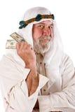 Dinheiro árabe da terra arrendada do homem Foto de Stock