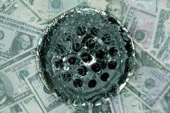 Dinheiro abaixo do dreno Fotografia de Stock Royalty Free