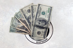 Dinheiro abaixo do dreno Foto de Stock Royalty Free
