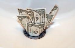 Dinheiro abaixo do dreno Fotos de Stock Royalty Free