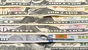 Dinheiro americano 5,10 da série do close up do fundo, 20, 50, nota de dólar 100 nova Cédula macro dos E.U. da pilha Fotos de Stock Royalty Free
