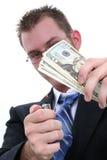 Dinheiro ardente do homem de negócio Fotografia de Stock
