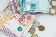 Dinheiro argentino e brasileiro Fotos de Stock