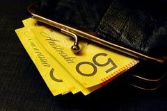 Dinheiro australiano na bolsa Imagem de Stock