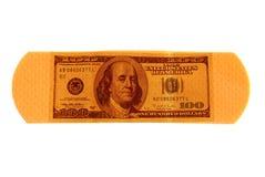 Dinheiro bandaid Imagem de Stock Royalty Free