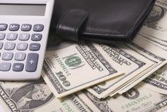 Dinheiro, bolsa e calculadora Fotografia de Stock Royalty Free