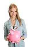 Dinheiro bonito da economia da mulher nova Fotografia de Stock Royalty Free
