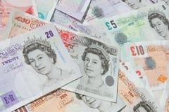 Dinheiro BRITÂNICO das notas de banco da moeda fotografia de stock royalty free