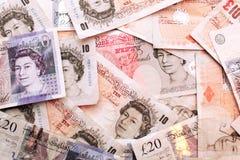 Dinheiro BRITÂNICO das notas de banco da moeda Fotografia de Stock