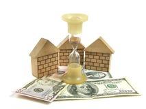 Dinheiro, casa, hourglass fotografia de stock royalty free