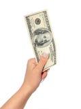 Dinheiro. cem dólares de conta à disposição isolada no branco Fotos de Stock Royalty Free