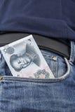Dinheiro chinês (RMB) em um bolso Imagem de Stock Royalty Free
