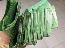 Dinheiro com mão Fotos de Stock Royalty Free