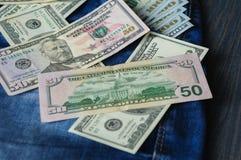 Dinheiro, dólares, em calças de brim ou em um bolso foto de stock royalty free