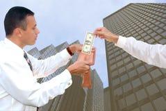 Dinheiro da açambarcamento Fotografia de Stock Royalty Free