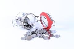 Dinheiro da economia no frasco e na bordadura Imagens de Stock Royalty Free