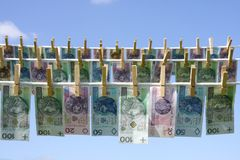 Dinheiro da lavanderia Imagens de Stock