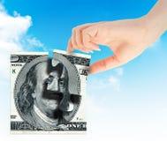 Dinheiro da mão e do elemento Fotos de Stock