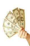 Dinheiro da terra arrendada da mão Fotografia de Stock