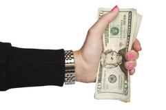 Dinheiro da terra arrendada da mão da mulher imagens de stock