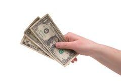Dinheiro da terra arrendada da mão da mulher Imagem de Stock Royalty Free