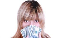 Dinheiro da terra arrendada da menina Imagem de Stock Royalty Free