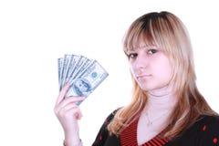 Dinheiro da terra arrendada da menina Imagem de Stock
