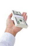 Dinheiro da terra arrendada da mão Fotografia de Stock Royalty Free