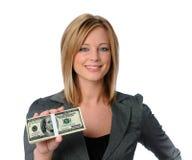 Dinheiro da terra arrendada da mulher Imagem de Stock