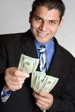 Dinheiro da terra arrendada da pessoa do negócio foto de stock