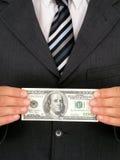 Dinheiro da terra arrendada do homem de negócios Fotos de Stock Royalty Free