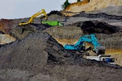 Dinheiro de escavação Foto de Stock Royalty Free