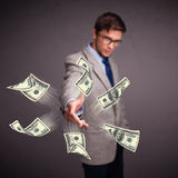 Dinheiro de jogo do homem novo Foto de Stock Royalty Free