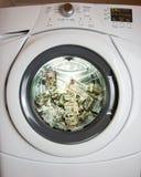 Dinheiro de lavagem Fotografia de Stock
