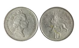 Dinheiro de metal BRITÂNICO, 10 moedas de um centavo imagem de stock royalty free