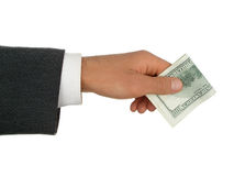 Dinheiro de oferecimento da mão do homem. Imagem de Stock