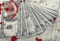 Dinheiro de sangue, dólares americanos fotografia de stock
