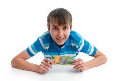 Dinheiro de sorriso feliz da terra arrendada do menino Fotos de Stock Royalty Free