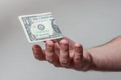 Dinheiro de travamento da mão Imagem de Stock Royalty Free