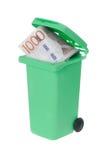 Dinheiro desperdiçado em um escaninho do recyle Imagens de Stock