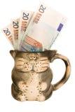 Dinheiro do euro da caneca Imagem de Stock