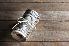 Dinheiro do rolo do dinheiro Fotografia de Stock