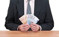 Dinheiro dos euro da terra arrendada do homem de negócios Imagens de Stock Royalty Free