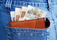 Dinheiro e calças de brim Fotos de Stock Royalty Free