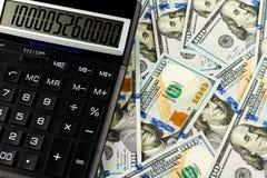 Dinheiro e calculadora Fotos de Stock